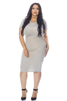 You'll be anything but basicin this stretch-knit tee dress! It features a mid-leg hem, round neckline and short sleeves. Unlined. Finished seams. Wear it with