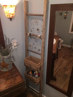 Old ladder used for bathroom organization. Could redo the vanity in the 1\/2 bath
