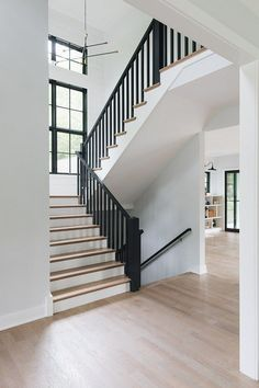 Modern Farmhouse House Tour Black Railing Staircase Modern farmhouse staircase black railing black spindles shiplap The staircase features black spindles and railings to match the black windows Black Railing, Black Stairs, Modern Railing, Black Painted Stairs, Stairs With White Risers, Painted Stair Risers, Steel Railing, House Staircase, Staircase Railings