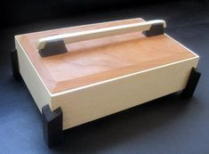 I cant seem to get away from making these little boxes. Here I present to you my most recent keepsake box made from American Holly, Cherry and Wenge. This box is the same design as many of my other boxes with the exception of the handle. Small Jewelry Box, Wooden Jewelry Boxes, Jewellery Boxes, Jewelry Chest, Wooden Keepsake Box, Keepsake Boxes, Woodworking Box, Woodworking Projects, Woodworking Classes