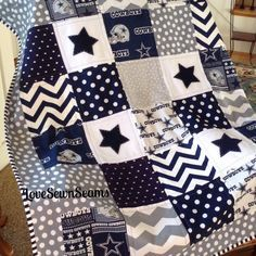 DALLAS COWBOY quilt in gray, navy and white by Lovesewnseams on Etsy https://www.etsy.com/listing/262011587/dallas-cowboy-quilt-in-gray-navy-and