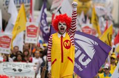 A union-led effort to raise wages at the fast-food chain is taking its campaign abroad, hoping to bring further pressure on the company.