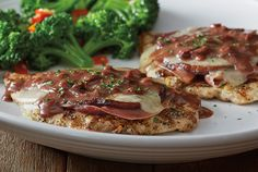 Pollo Sorrento - Wood-grilled and topped with sauteed eggplant, prosciutto, fontina cheese and our port wine fig sauce
