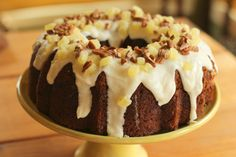 This decadent Hummingbird Bundt cake with cream cheese filling and pineapple cream cheese glaze is a Southern classic.