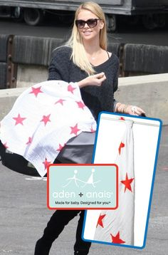 Charlize Theron carries her baby with an Aden + Anais swaddle. Order at babylunaboutique.com