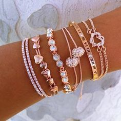 jewelry This elegant Rose Gold Everything bracelet set includes: a wrap crystal cuff a multi-heart bracelet a round cz crystal tennis bracelet a double cz disco ball bracelet a Roman numeral Cute Jewelry, Jewelry Box, Jewelry Accessories, Jewelry Necklaces, Jewlery, Jewelry Stores, Jewelry Displays, Jewelry Stand, Jewelry Findings