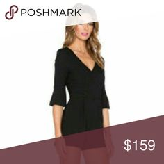 Black Halo 3/4 sleeves romper Brand new BLACK HALO 3/4 sleeves pleated romper in black size 8 with side pockets and hidden zipper Black Halo Dresses Long Sleeve