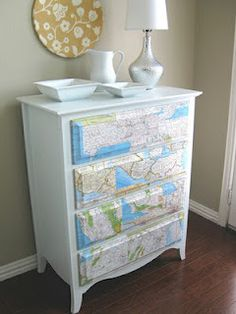 Use a map to brighten up a drab dresser.  Love that she just did the drawers so they stand out.