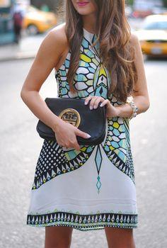Aztec print dress, Tory Burch clutch.