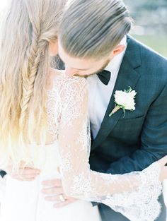 the sweetest groom's kiss - photo by Christine Pienaar Photography http://ruffledblog.com/crisp-coastal-bridal-inspiration