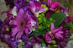 Pink Gerbera Daisies, Fuchsia Dendrobium Orchids, Green Hypericum Berries and Purple Alstromeria in a Bridesmaid's Bouquet. Created by Lexington Floral in Shoreview, MN