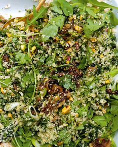 "green couscous // from ""plenty."" really good! made some modifications (added lentils + feta, used almonds instead of pistachio, omitted cilantro / green onion)"