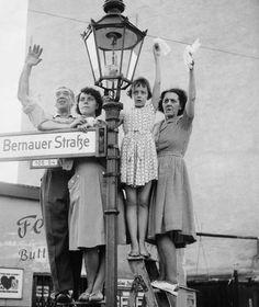 The wall in Berlin. West-Berlin people waving to East-Berlin. 1961