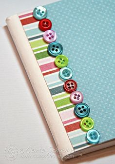 Button border on embellished composition notebook