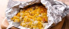 Grilled Cheesy Potato Pack - Comfort food on the grill! And cleanup's a snap with foil-packet grilling.