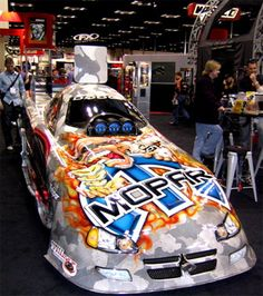 2006 Indy Dealer Expo: NHRA Funny Car Series Drag Car, sponsored by Mopar and Oakley, was on display. Driven by Gary Scelzi, who has been in the Top Fuel Class of NHRA Drag Racing and is ranked at the 4th most dominant driver in Motor sports