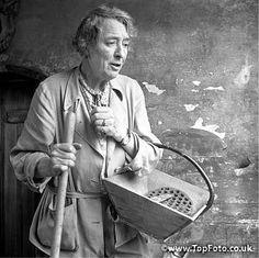 Vita Sackville West with gardening tools 1958