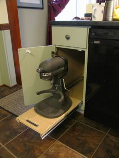 DIY Kitchen Cabinet For A Mixer. Alton Brown has one that pulls out and raises up to counter top height!
