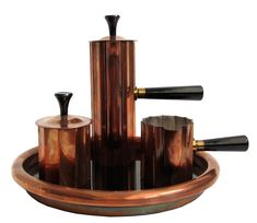 Set in Copper for Chase This four piece American art deco Diplomat coffee set designed by Walter Von Nessen (1889 – 1943) for the Chase Brass and Copper company in 1933 is rarely seen in copper. The story goes that Von Nessen, on being retained by Chase, wandered through their warehouse and discovered a stock of unused fluted tubing in their inventory and modified it to make the set.