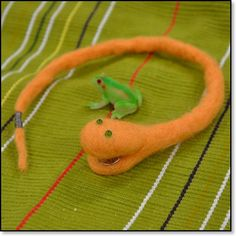 Felted LED Snake - When the snake places its tail in its mouth, it's eyes light up.