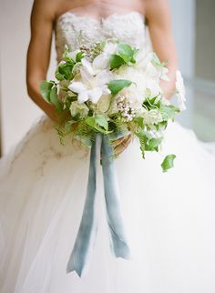 white peonies and clematis blooms and vines. A pale gray blue ribbon