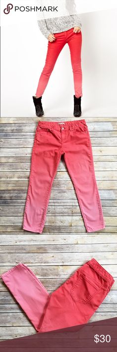 Free People Red/Pink Ombré Ankle Jeans Super fun ombre Ankle Jeans! Pretty vibrant red fades to a pink color. Good used condition, 2 small stains on front left pant leg (see last photo for reference) Front rise measures approximately 8 1/2 inches, waist corner to corner is approximately 16 inches, inseam approx 27 inches. Fabric content is 78% cotton 20% polyester and 2% spandex. Free People Jeans Ankle & Cropped