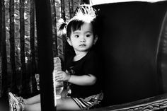 Ho Chi Minh | Vietnam | Little girl in the back of Dads Tuk Tuk in the after work rush hour