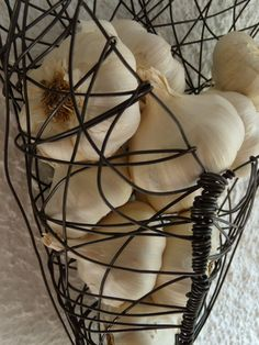 Hey, I found this really awesome Etsy listing at http://www.etsy.com/listing/66196884/wire-basket-wall-hanging-garlic-basket