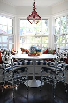 Bay window banquette | Jamie Meares, lucite chairs, pattern mix, chiang Mai dragon fabric, Parker pendant, furbish studio