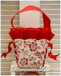 SALE \/ RED DAMASK PAPER BASKET with CREPE PAPER RUFFLES and RIBBON HANDLE. $15.00, via Etsy.