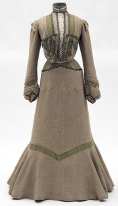 1901 - 1902. Two-piece natural colored linen dress with green silk underslip.  Linen fabric