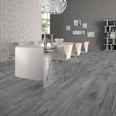 offers an exclusive range of ceramic and porcelain wood look tiles. Buy quality flooring tiles at affordable prices! Flooring, House Flooring, Dining Table Chairs, Wood Tile Floors, Gray Wood Tile Flooring, Home Decor, Wall And Floor Tiles, House Interior, Room Interior