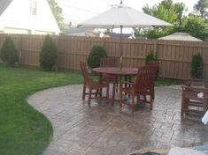 Backyard: Stamped concrete patio.