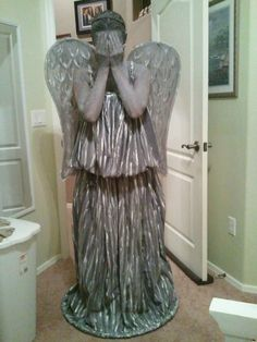 Weeping Angel Halloween costume:  grey full sized flat sheet, grey curtain tie back, grey tank top, angel wings painted grey, and a hula-hoop sewn into the hem.