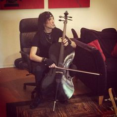 Christian Coma playing Jinxx's cello during the recording process of Wretched and Divine.