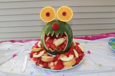 Monster birthday food -- This is cute, but I think it will be hard to find watermelons in Dec.