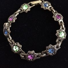 Faux Antique Bracelet Antique looking bracelet with royal blue, purple and green gems. Fold-over clasp. Like new. Smoke free home. Jewelry Bracelets