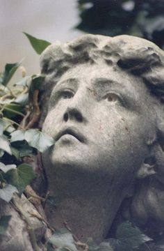 ivy clad sculpture from Highgate's East Cemetery