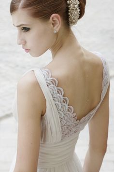 The way something as simple as layered scalloped lace can create such a stunning effect. | 50 Gorgeous Wedding Dress Details That Are Utterly To Die For