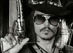 Johnny Depp wearing shades of Elvis