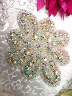 Crystal AB Floral Glass Silver Beaded Rhinestone Applique  Measures: 3\ x 2.5\   All measurements are approximate.  Application: Sew, glue or iron on.