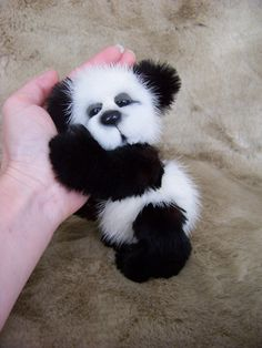 "Artist Miniature Mink Jointed Teddy Bear Cub  ""Bitsy"". $189.99, via Etsy."