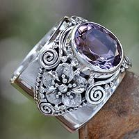 Amethyst cocktail ring, 'Lilac Frangipani'. Adorned by frangipani blossoms, this design is the creation of Buana in Bali. Crowning ornate sterling silver settings, a faceted amethyst of 3.5 carats takes center stage in a ring of feminine elegance. .925 Sterling silver