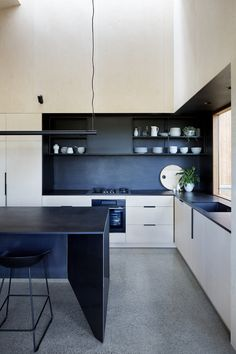 Two Halves House - Moloney Architects ply, paper rock, matt black, island bench kitchen