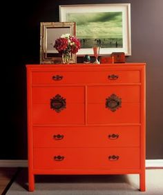 bright dresser against dark wall