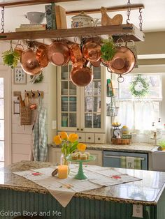 Spring decor in cottage style kitchen with farmhouse sink. Decor, Pot Rack, Farmhouse Sink Kitchen, French Kitchen Decor, Diy Pots, Tuscan Decorating, Cottage Style Kitchen, Mediterranean Decor, Kitchen Wall Decor
