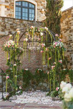 flower covered wedding ceremony arbor @weddingchicks