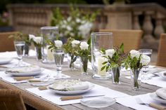 Create a classically beautiful table setting simply with candle light and our gorgeous silk flowers. Here we have combined our hurricane lanterns with some arrangements made from trimming our astrantia and white rose single stems.