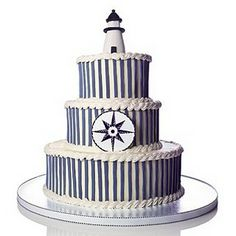 lighthouse as a topper, with blue and white stripes and a compass. Cut cake!  Not w the stripes