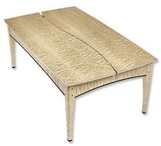 """This maple coffee table, created by avid fly-fisherman Al Swason, celebrates the western rivers of his home state of Montana. Rare western quilted maple, reminiscent of Madison River riffles, is bridged by a """"river"""" cutaway of aluminum rod for a contemporary touch that also allows the top to expand and contract regardless of the climate. A hidden compartment in the base houses a handwritten note by its maker."""